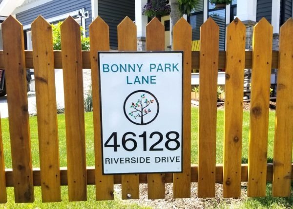 sign mounted on fence