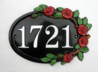Cast metal sign with rose